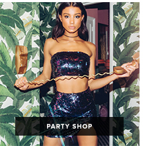 Party Shop: dark haired woman in blue sequin two piece tube top and skirt set holds a telephone and cord in a palm print room
