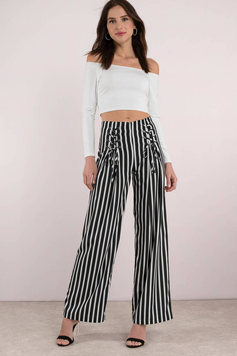 Vertical striped pants are essential for looking classic and modern. Dress trousers in white printed with skinny stripes in very dark navy. Constructed with button-up fly, belt loops and adjustable drawstring tie.