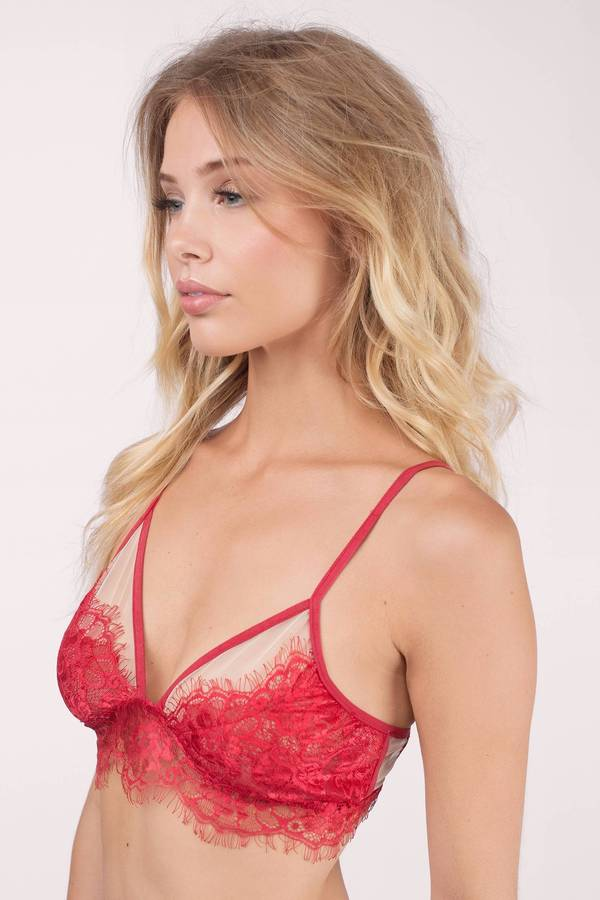 This romantic red Yandy Collection bra features lightly padded, underwire demi cups with a lace overlay, a scalloped trim, a satin bow accent, adjustable velvet spaghetti straps, a velvet underbust band, and a sheer back band with a hook and eye back closure.