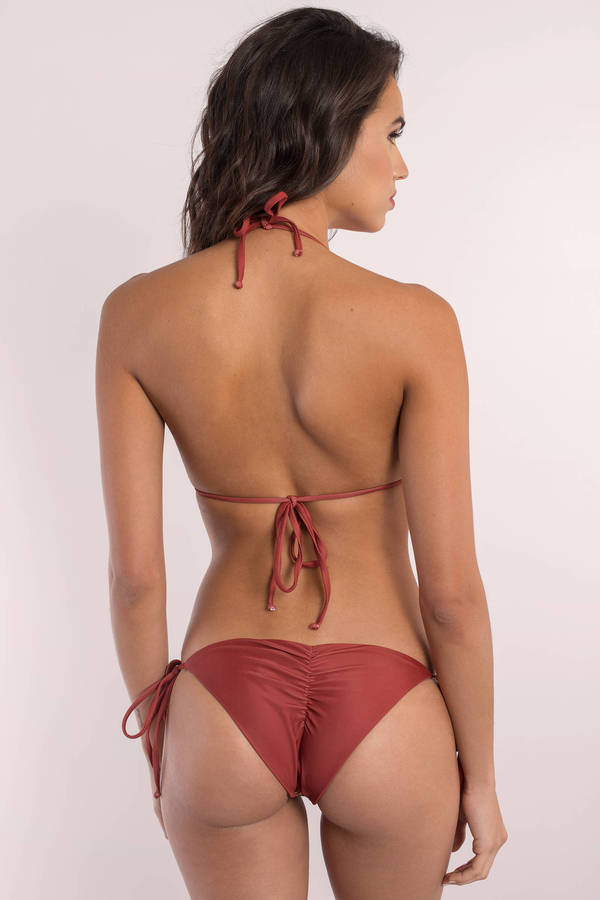 We have been all smiles since the arrival of the Rhythm My Cheeky Wine Red Bikini Bottom! These stretchy knit, low rise bikini bottoms have pierced embroidery, and a ruched back with cheeky cut/5(7).